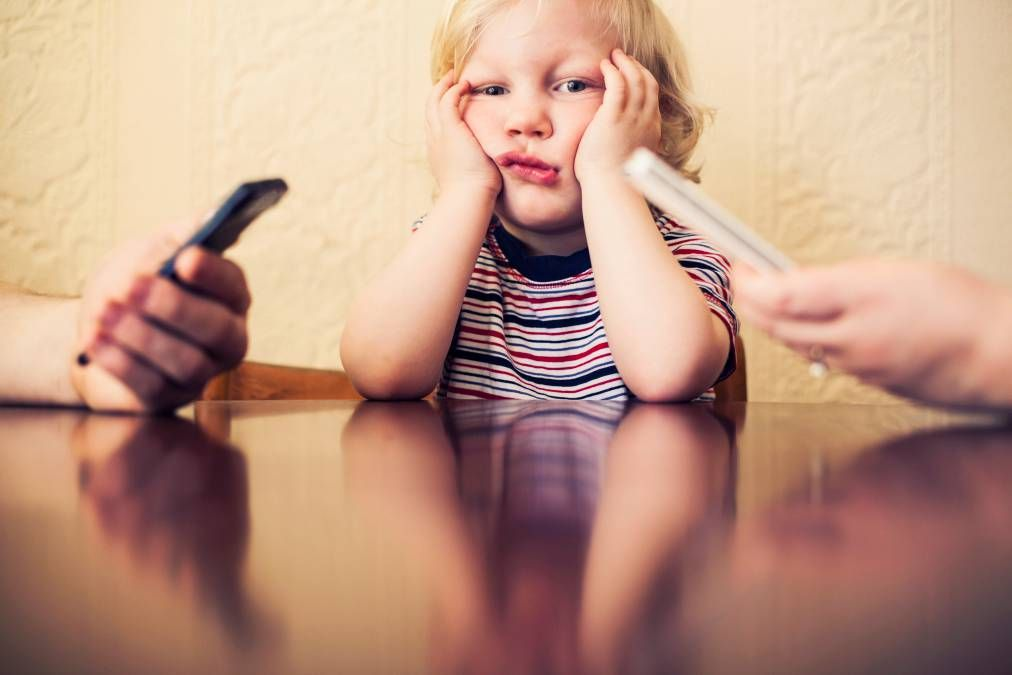 A new study from Boston Medical Center reveals that parents who get absorbed by email, games or other apps have more negative interactions with their children, making them feel like they're competing for attention with their parents' gadgets