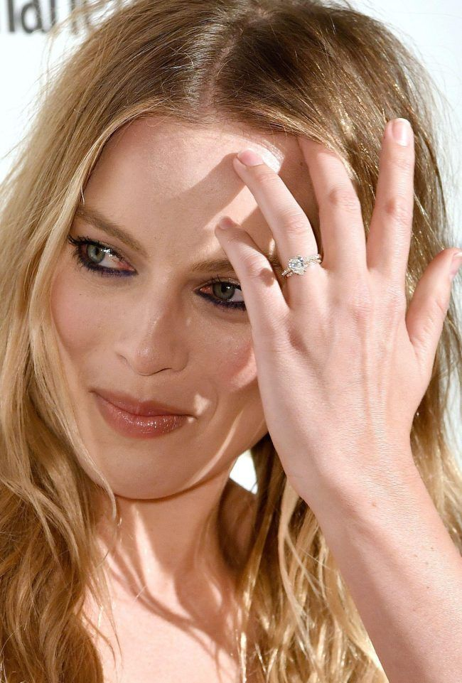 72a179e310a Margot Robbie shows off her enormous wedding ring during first red ...