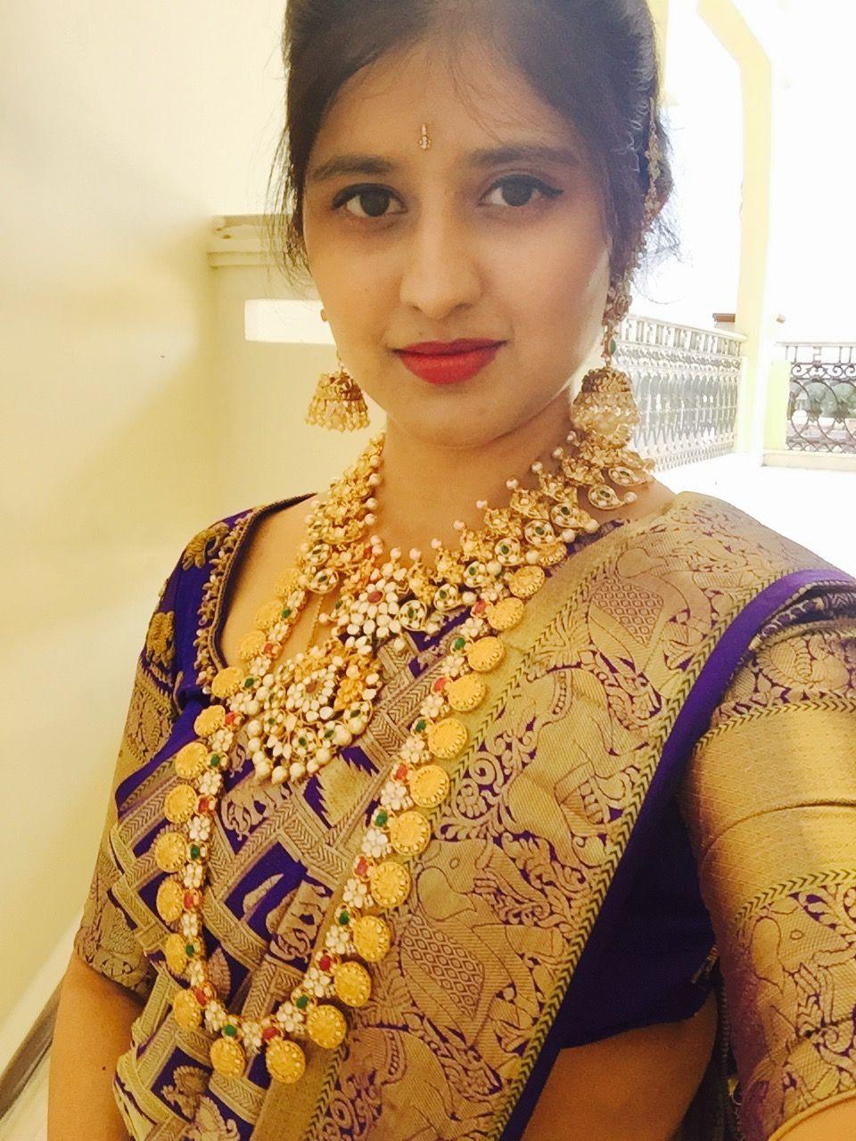 Saree jewellery images bride in dark blue saree and mango mala and varalamala  necklace