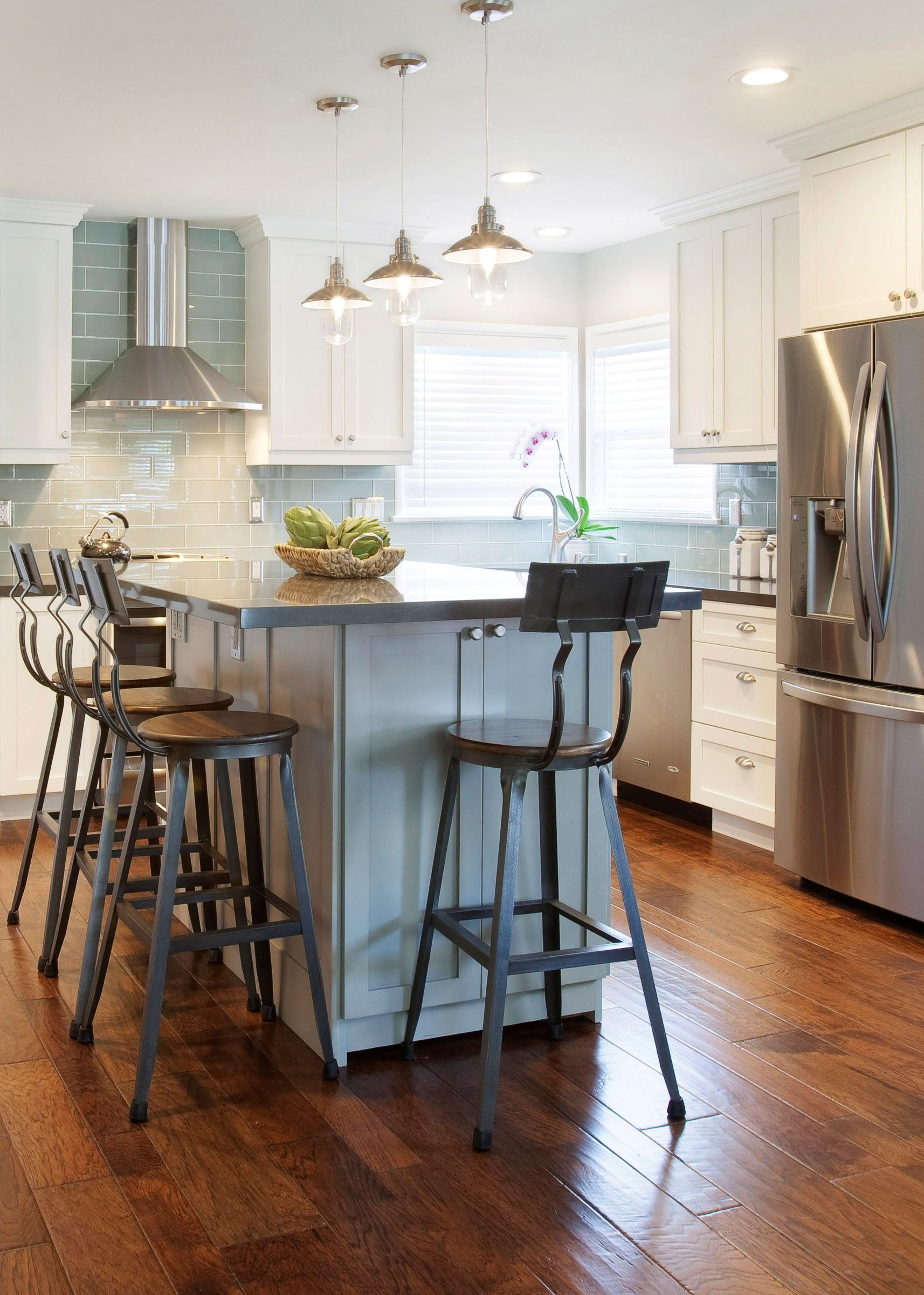 These downtown edison brushed nickel pendant lights in this kitchen