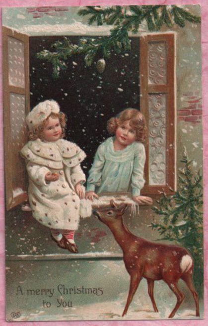 PRETTY CHRISTMAS GIRLS SHARE TREAT W/ DEER FRIEND Snowy EAS POSTCARD 1908 #Christmas