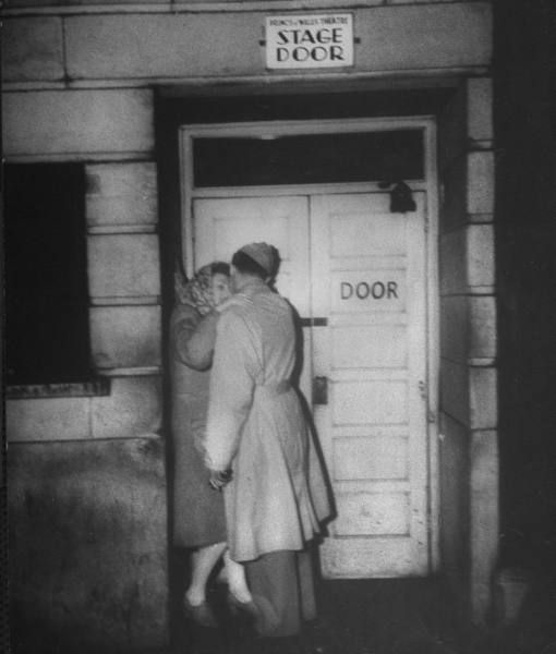 A soldier and his girl at the stage door of the Prince of Wales theatre during London's 1944 blackout