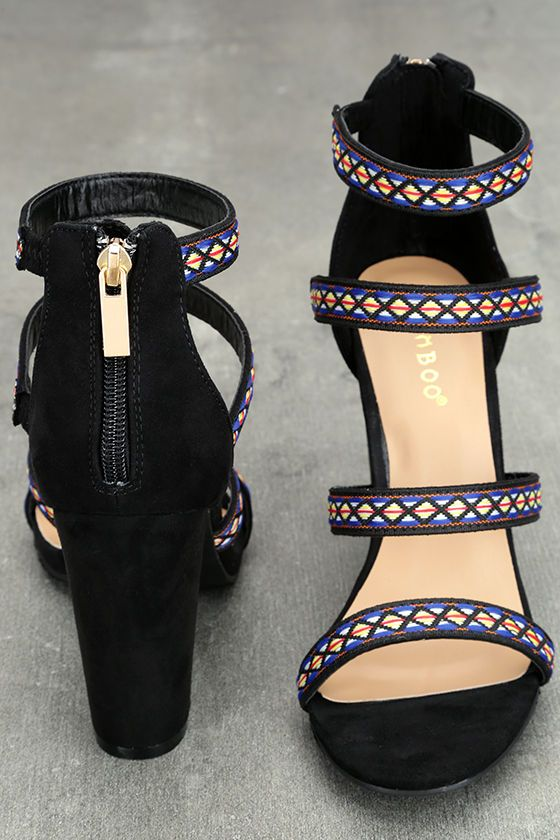 """An ultra glam silhouette is given the Boho treatment with the Mariko Black Suede Embroidered Caged Heels! These luxe vegan suede heels have a cagey upper trimmed in blue, orange, yellow, and white embroidery. 3"""" heel zipper."""