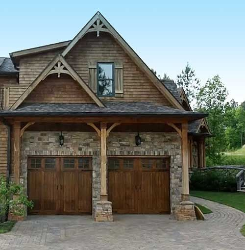 The curved timber braces reflect the rounded gable trims for Wood veneer garage doors