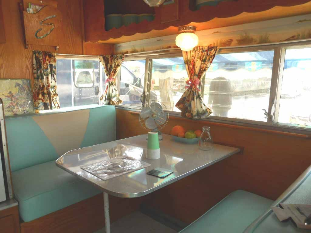 Warm and cozy dinette area in vintage 1962 Shasta Travel Trailer