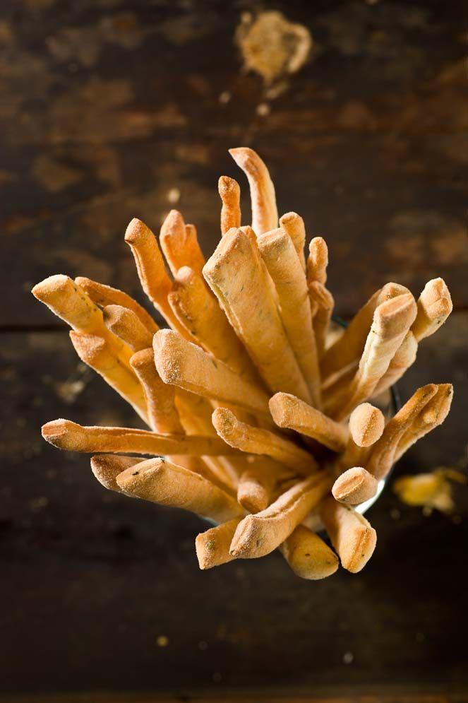 Complimentary crispy bread sticks.