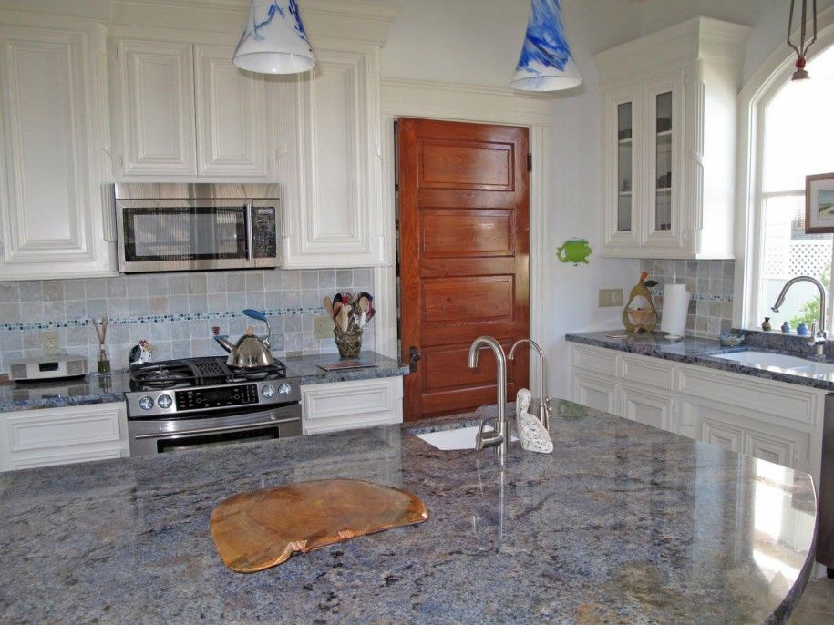 Blue Bahia Countertop And Backsplash White Cabinets