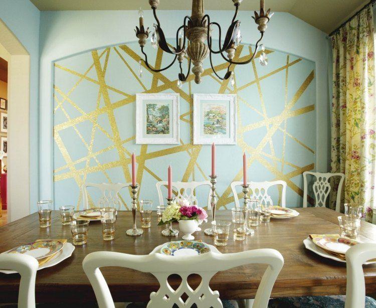 Esszimmer mit dekorativer Wandgestaltung in Türkis und Gold - muster an der wand malen