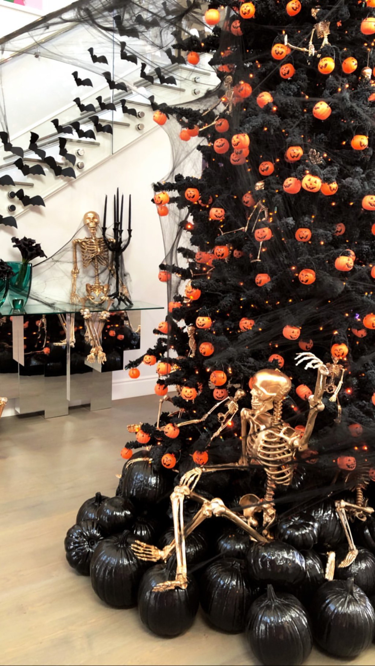 Kylie Jenner Halloween 2020 Black Halloween tree with orange pumpkins Kylie Jenner home in