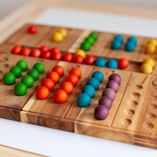 Wooden counting board with rainbow marbles by QToys - fair ...