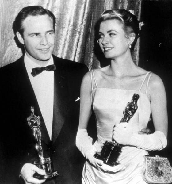 Beautiful shot of Grace Kelly and Marlon Brando, with their Oscars