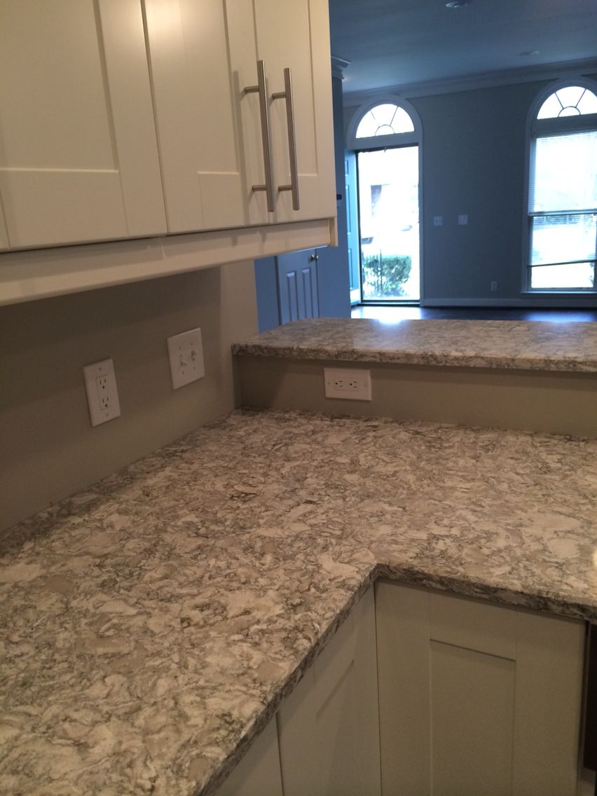 Perfect neutral quartz as alternative to marble cambria for Cambrian kitchen cabinets