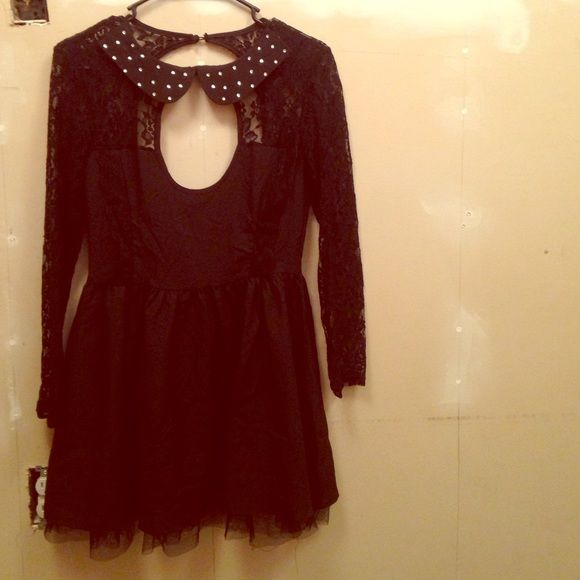 Black dress Black dress. Size: Small. Never worn! Features: lace arms and rhinestone collar. Open back Dresses Mini