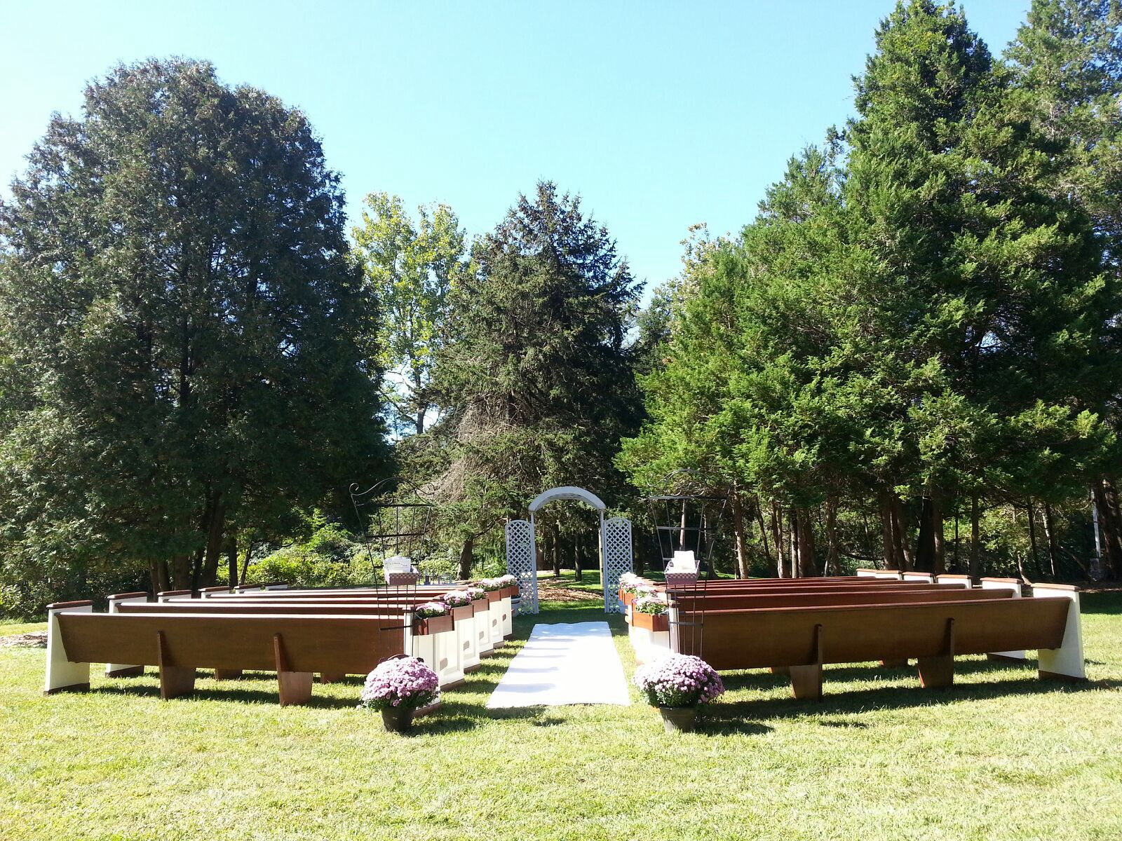 "Another great view of this awesome ""church pew"" style ceremony seating from a recent"