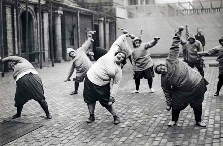 Group fat women undergoing slimming course in a courtyard in New York, 1920s.