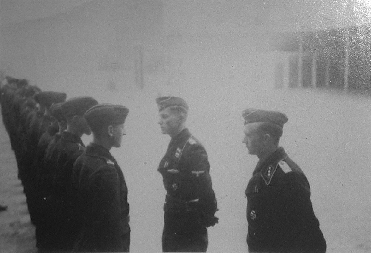 Peiper welcomes new arrivals to 1PzRgt from right usf Koechlin Hasselt spring1944