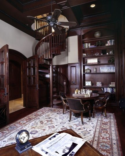 Spiral staircase and Dark wood.   Basement ideas ...