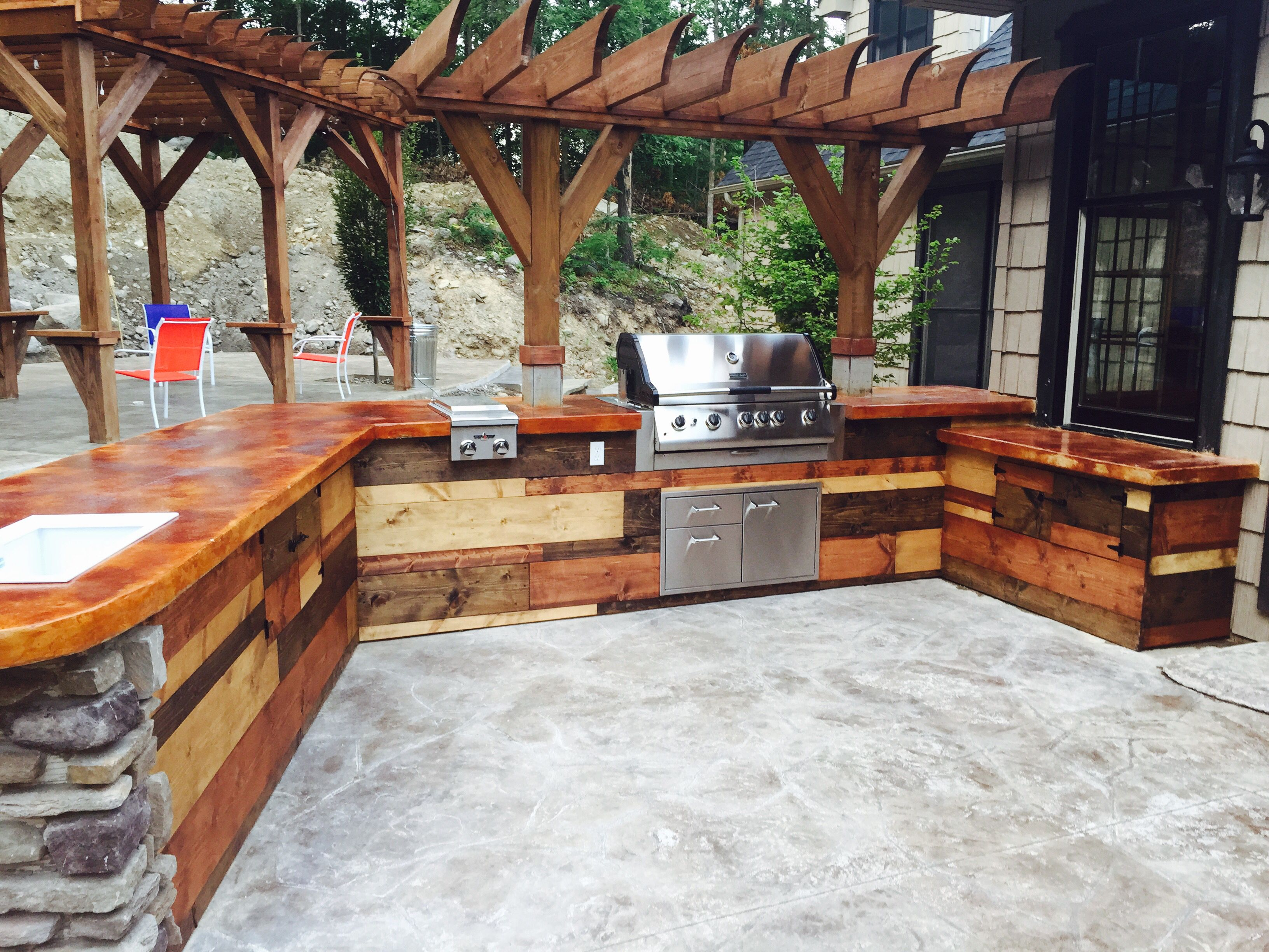 Grill, Concrete Countertop, Mixed Wood Rustic Cabinets, Stamped Concrete  Patio.
