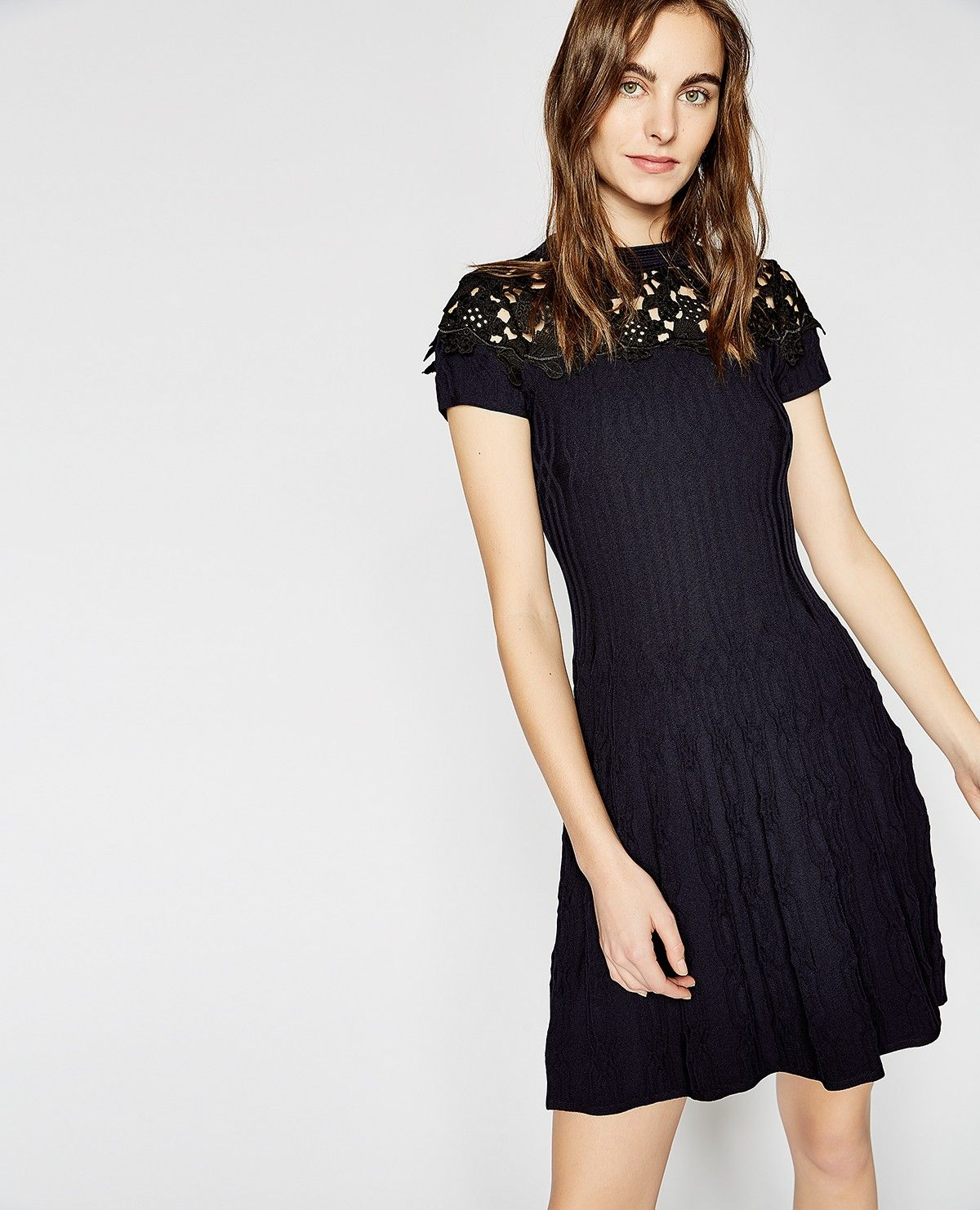 This short dress is made from figure hugging stretch knit the navy