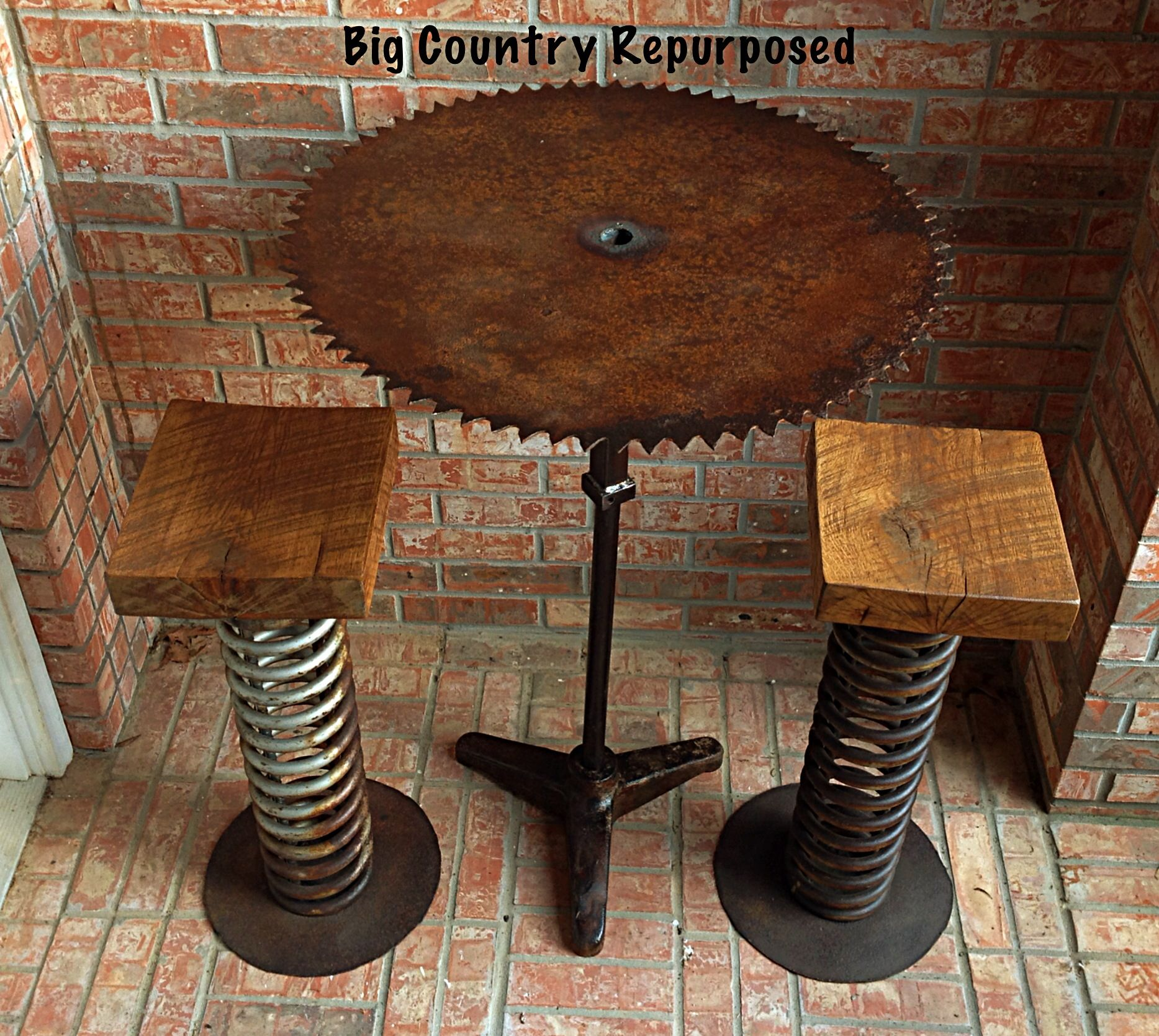 This is a bar height table using antique sawmill blade and for Repurposed metal furniture