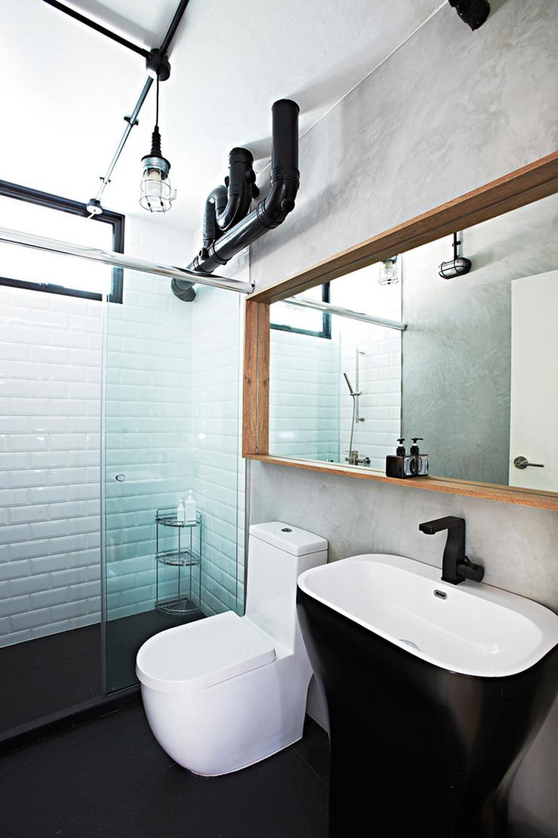 The black pedestal washbasin and matching water faucet stand out in ...