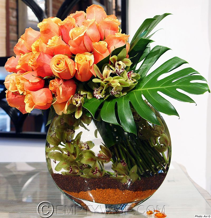 Love the fishbowl look with peach roses and orchids