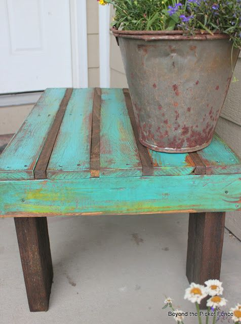 coffee table made from a pallet, pieces of wood just wedged into the
