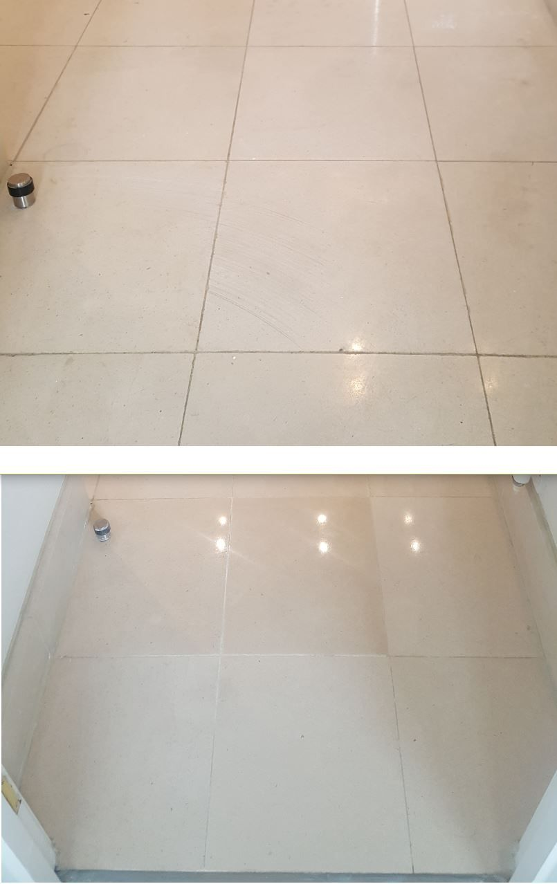 A limestone bathroom floor scratched by an incorrectly