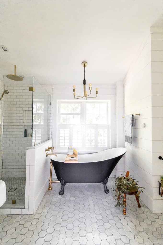 Modern Black and White Bathroom with Brass Accents