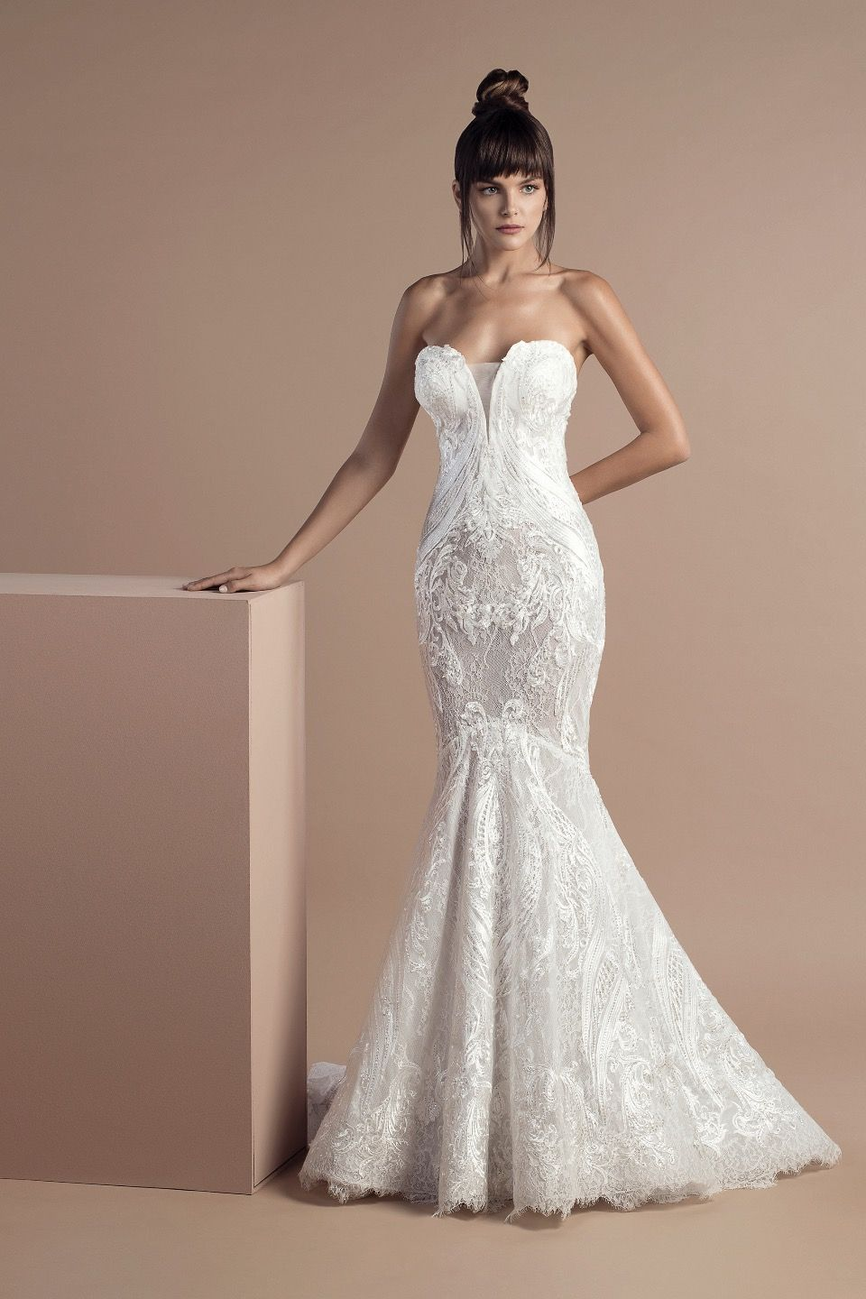 7dcc851704dc Off white mermaid dress in lace and tulle embroidered with silk thread,  with a strapless sweetheart bodice and a Court train.