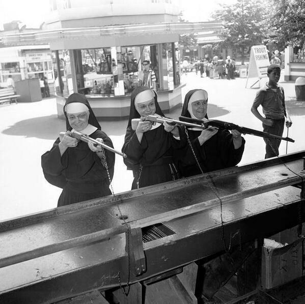 Nuns firing guns at a carnavel...