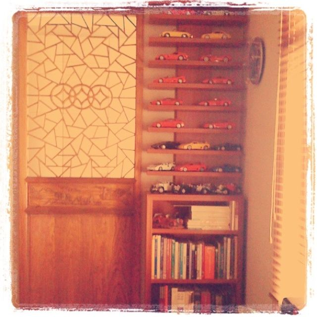 Antique sliding door and hub's cars collection on our study