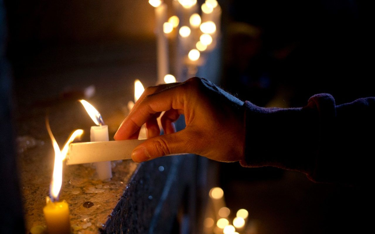 A man places a candle during a vigil in front of the US embassy in honour ofthe victims oftheshootingin Orlando, inSantiago, Chile.