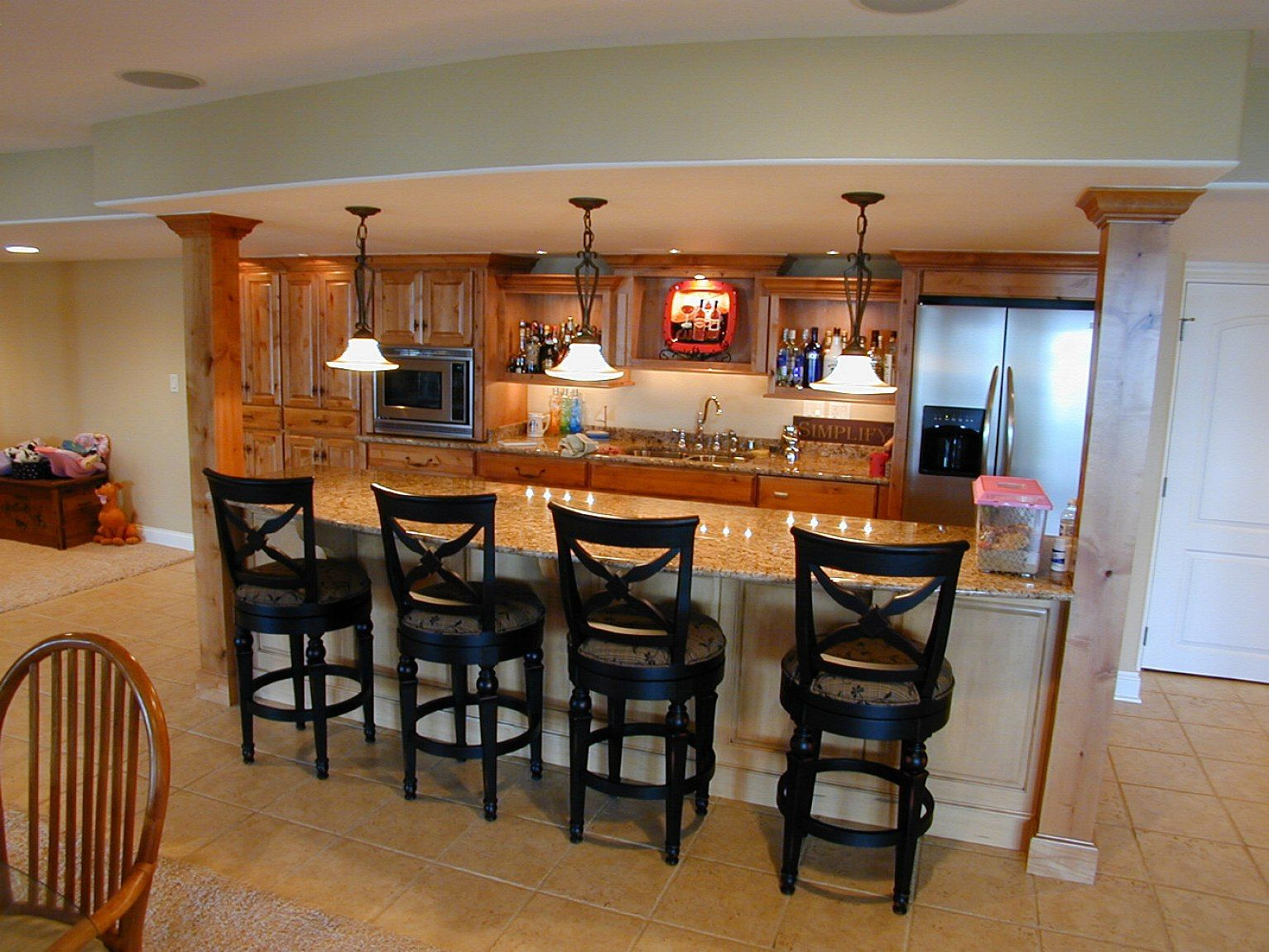 Finished basement ideas basement finishing with mini bar for Finished basement designs