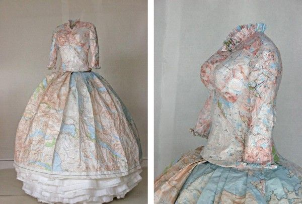 These dresses made of paper maps and money are Susan Stockwell's sculptural study on colonialism and the British empire. Empty life-sized female dress composed of ordinance survey maps glued together. Stockwell delivers a visual blow to English colonization and occupation of Scotland over 300 years. Using military maps to create a woman's dress sends a double message of war and politics being dominated by men in Western history.