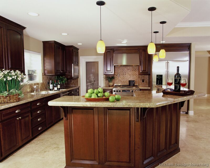 Luxury Cherry Kitchen with a Large Island Bar  plus a Travertine Floor and  Backsplash. Luxury Cherry Kitchen with a Large Island Bar  plus a Travertine