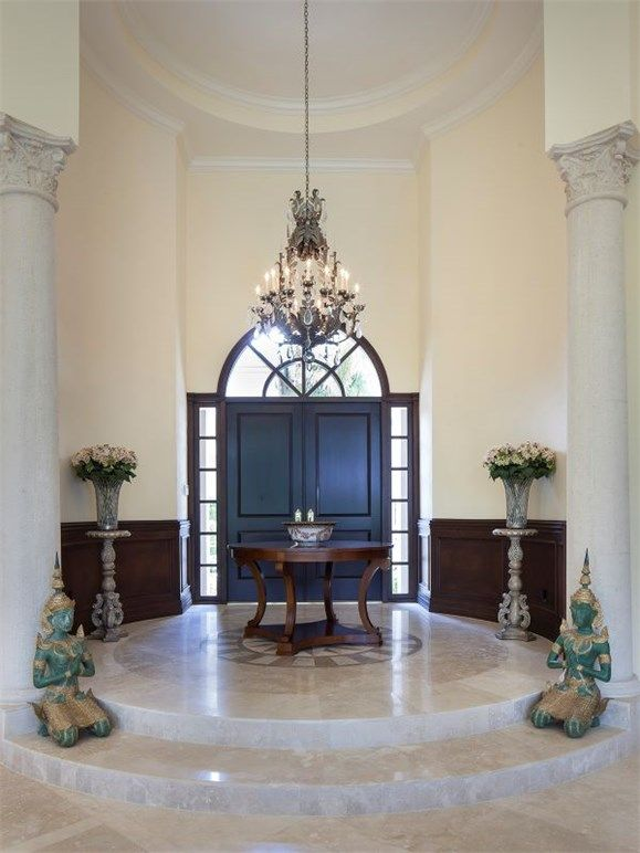 9675 Mashie Ct, Naples, FL 34108 | Round foyer with chandelier and statues.  Namaste.   At the Estates at Bay Colony Golf Club.  Premier Sotheby's International Realty