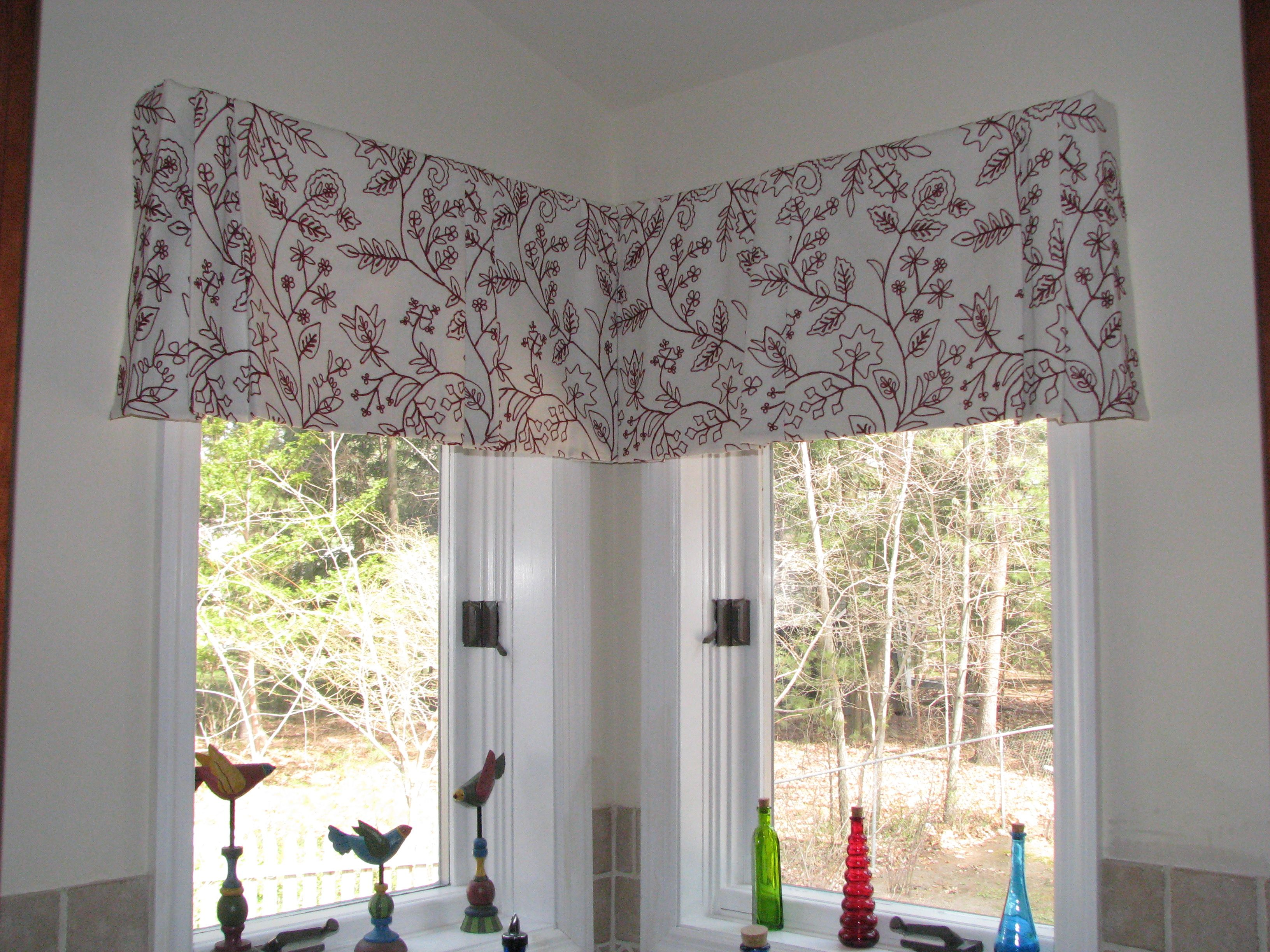 Tailored pleated valance for corner window in embroidered linen