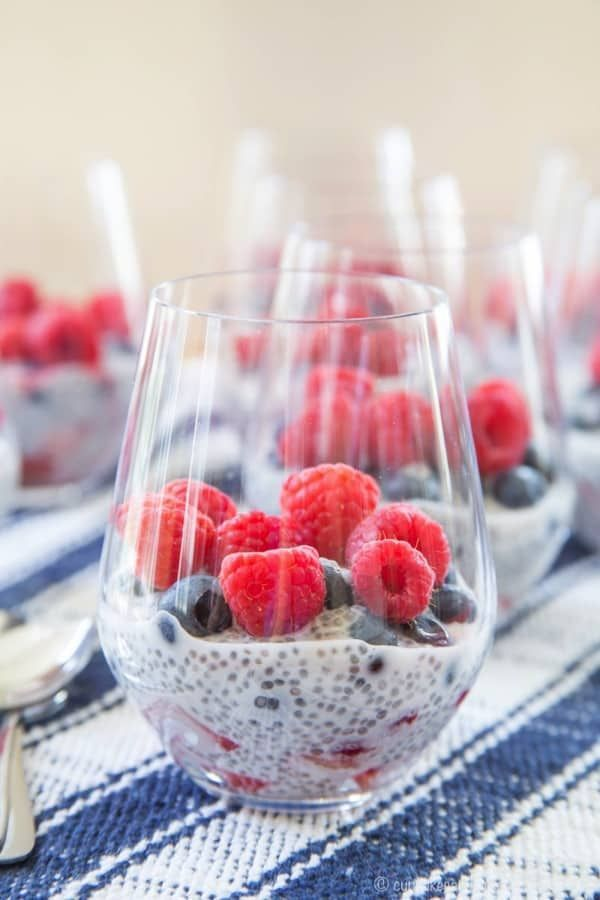 Berry Coconut Chia Pudding Parfaits - the perfect summer breakfast, snack, or dessert when fresh berries are in season. Layer fresh strawberries, blueberries, and raspberries with coconut chia cream for a superfood treat for Memorial Day, Fourth of July, or Labor Day menu that is gluten ...