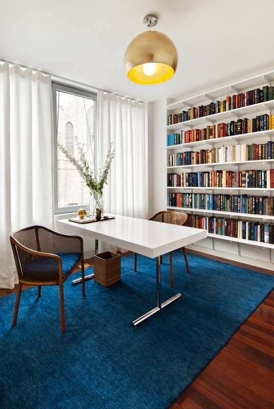 I like the idea of the desk coming out of the window with seating on both sides. Office?