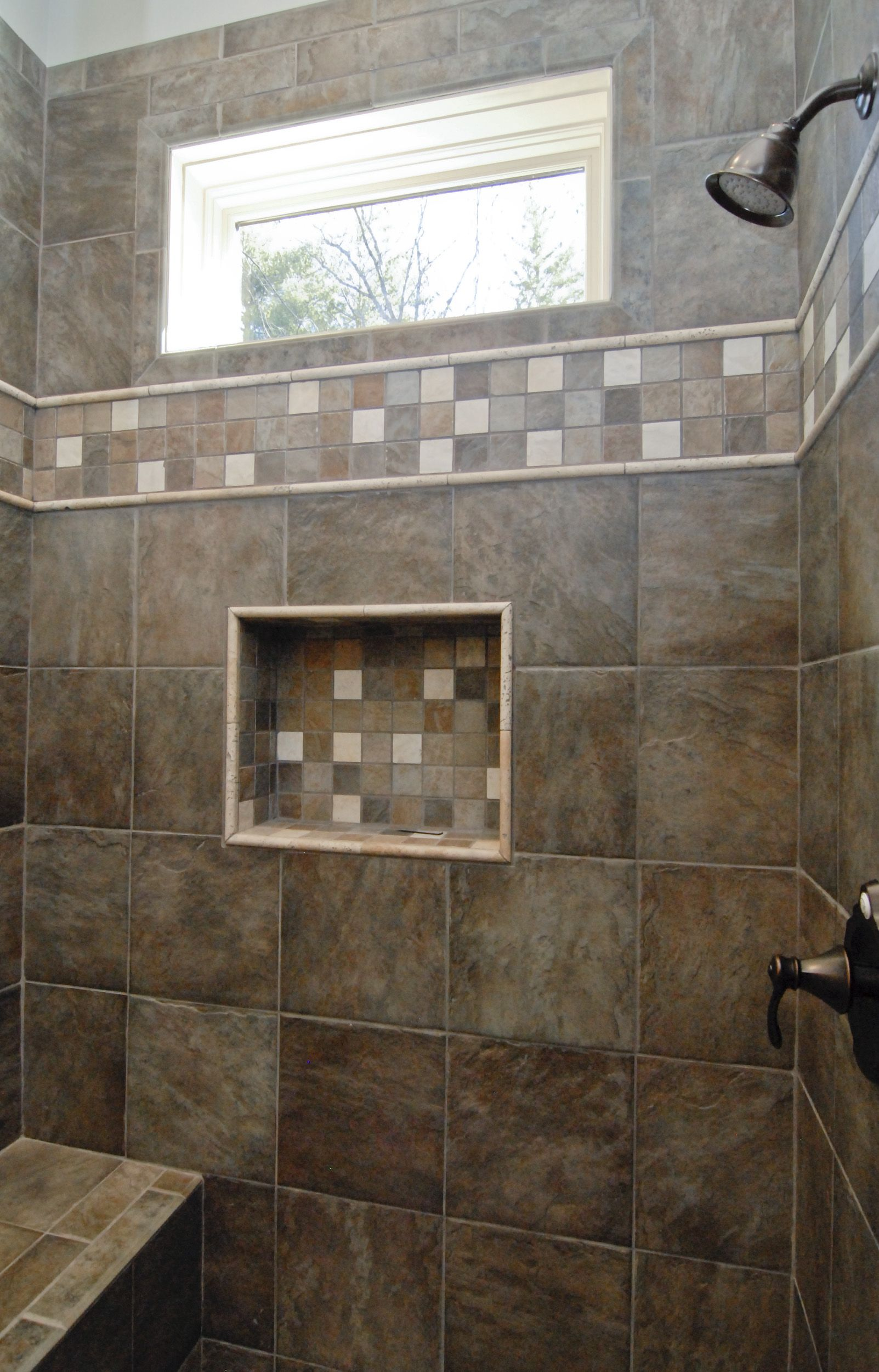 Gorgeous Dark Brown Custom Tile Walk In Shower With A Window And Bench Www Goodwinfoust Com Tile Walk In Shower Window In Shower Shower Remodel