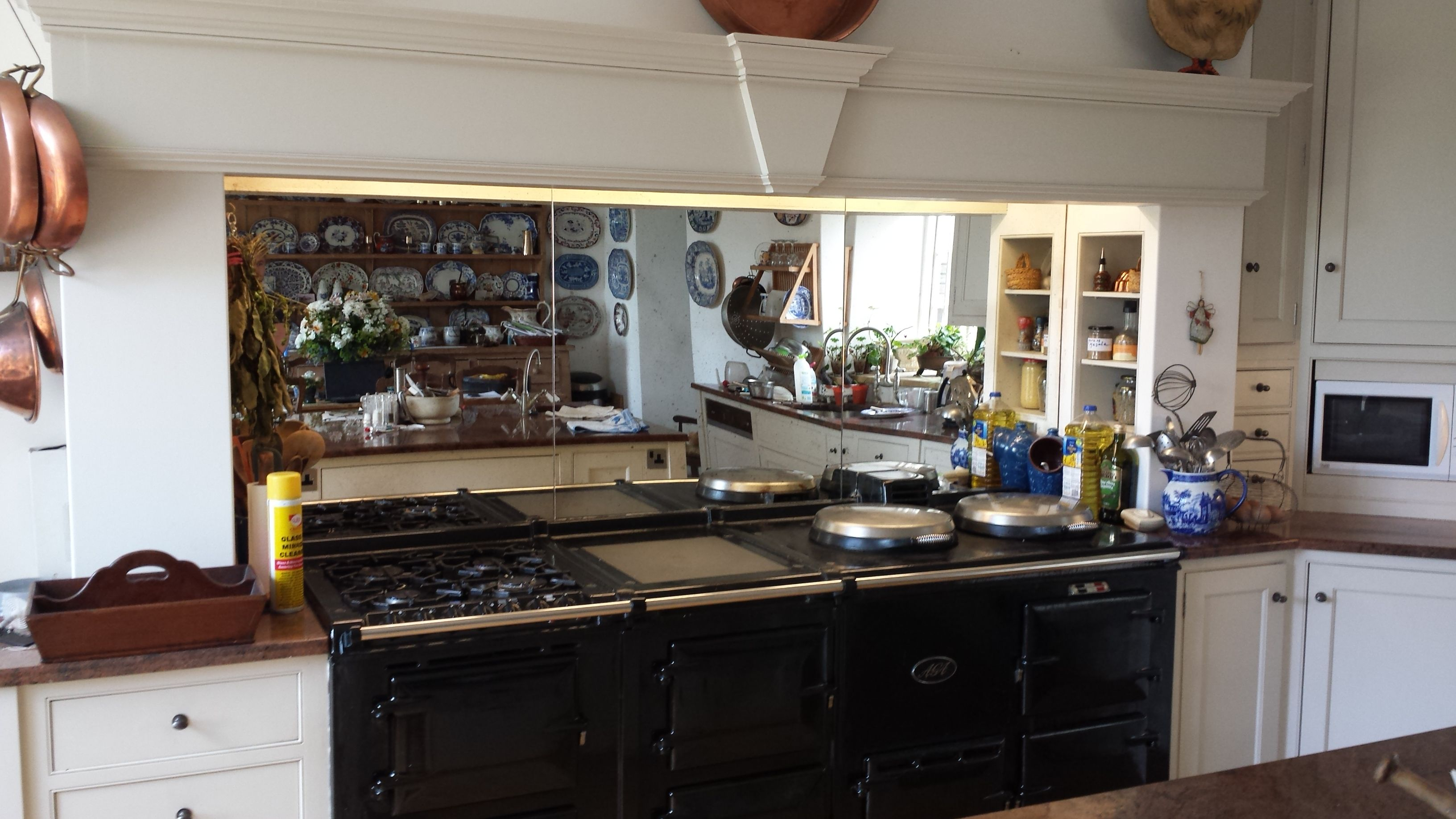 Antique Mirror Used As A Splashback Behind An Aga Reflecting Light Giving The Illusion Of A Greater Space Kitchen Beautiful Kitchens Kitchen Cabinets