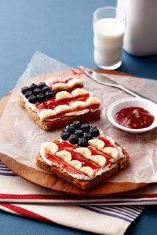 Quick 4th Of July Open-Faced Breakfast Sandwich  Ingredients:  4  slices Whole wheat bread, toasted  8  oz. Whipped cream cheese  1  pint Blueberries  1/4  cup Strawberry preserves  2  whole Chiquita bananas, peeled, sliced in half lengthwise and then sliced into half moon shaped slices  Instructions For: