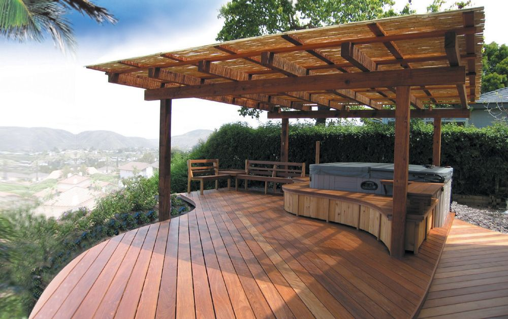 Custom built wooden curved deck with hot tub