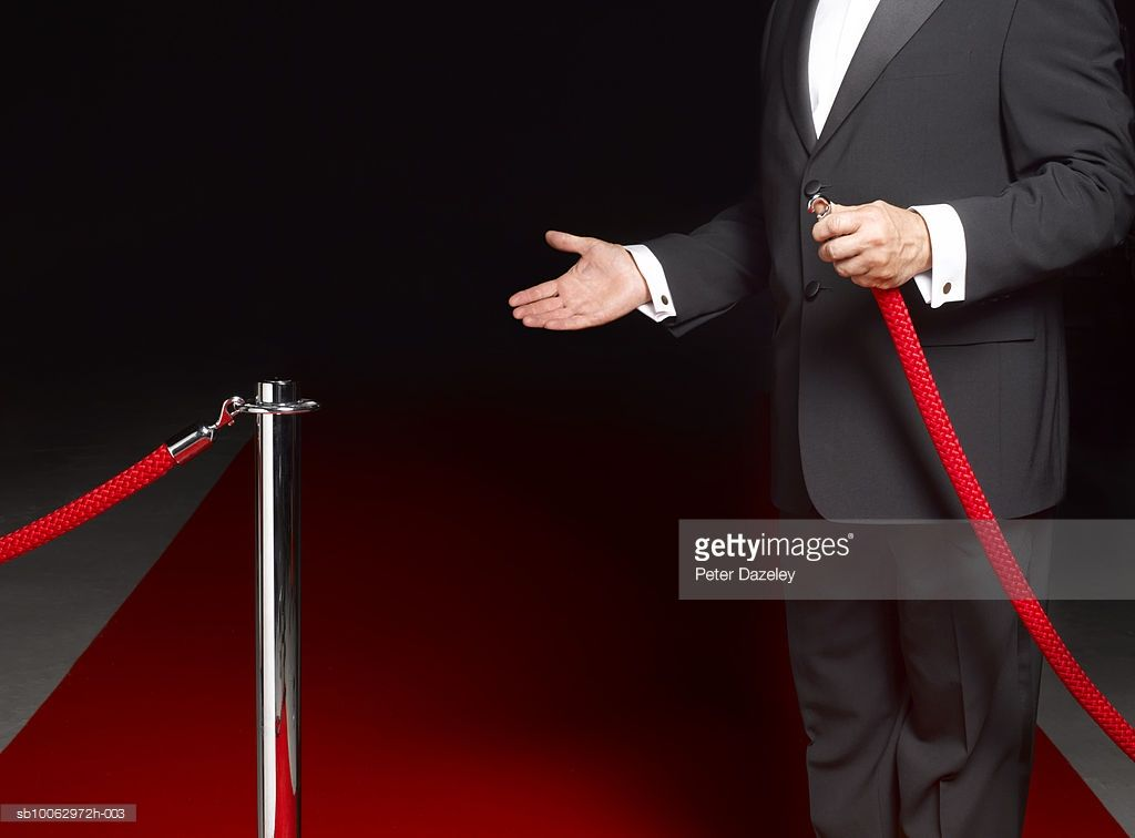 security-man-showing-way-past-rope-on-to-red-carpet-mid-section-picture-idsb10062972h-003 (1024×756)