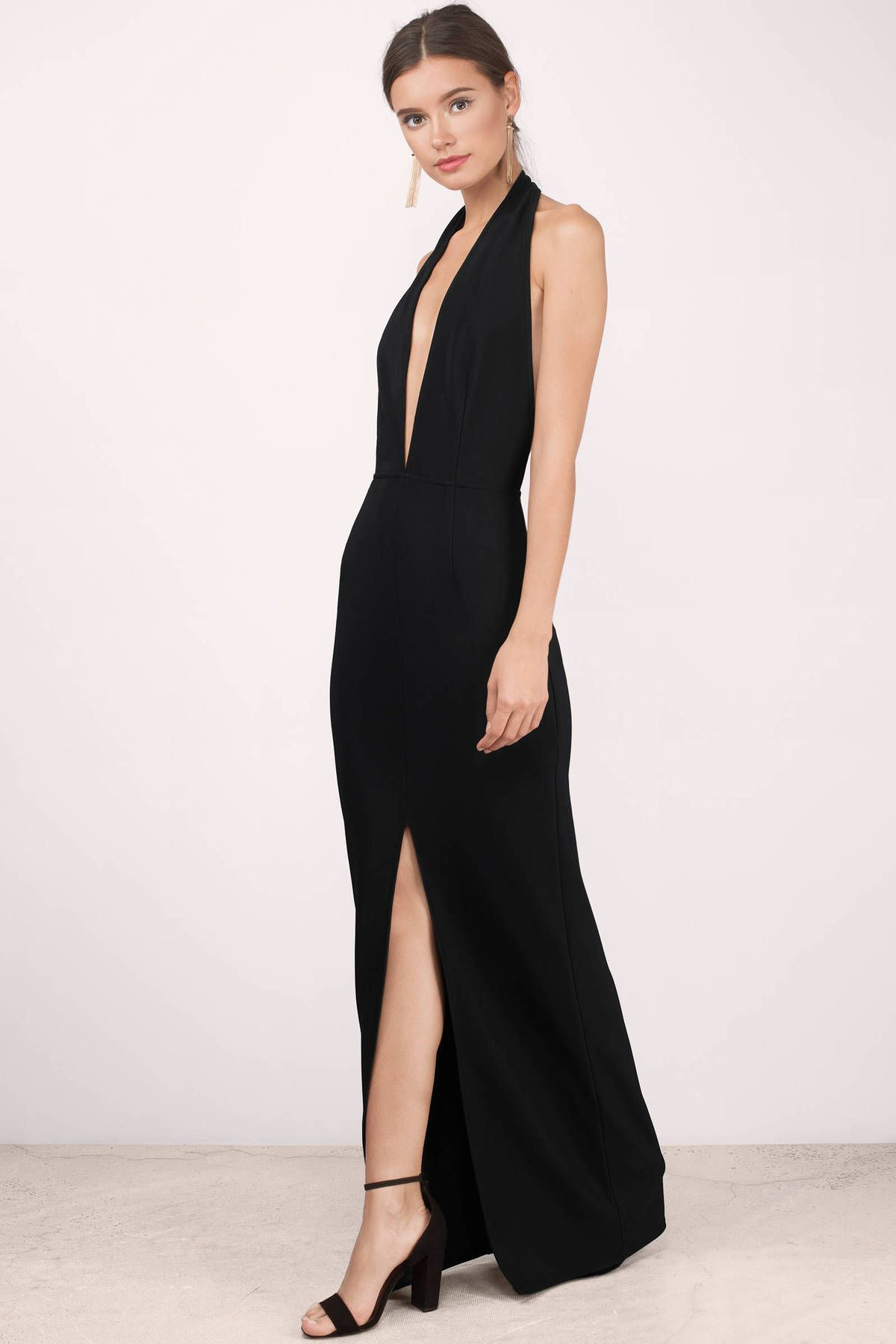 Turn heads with the Gala Deep Neck Maxi Dress. Featuring a halter plunging  neckline and backless maxi dress. Pair with heels and sta 26940eab4931