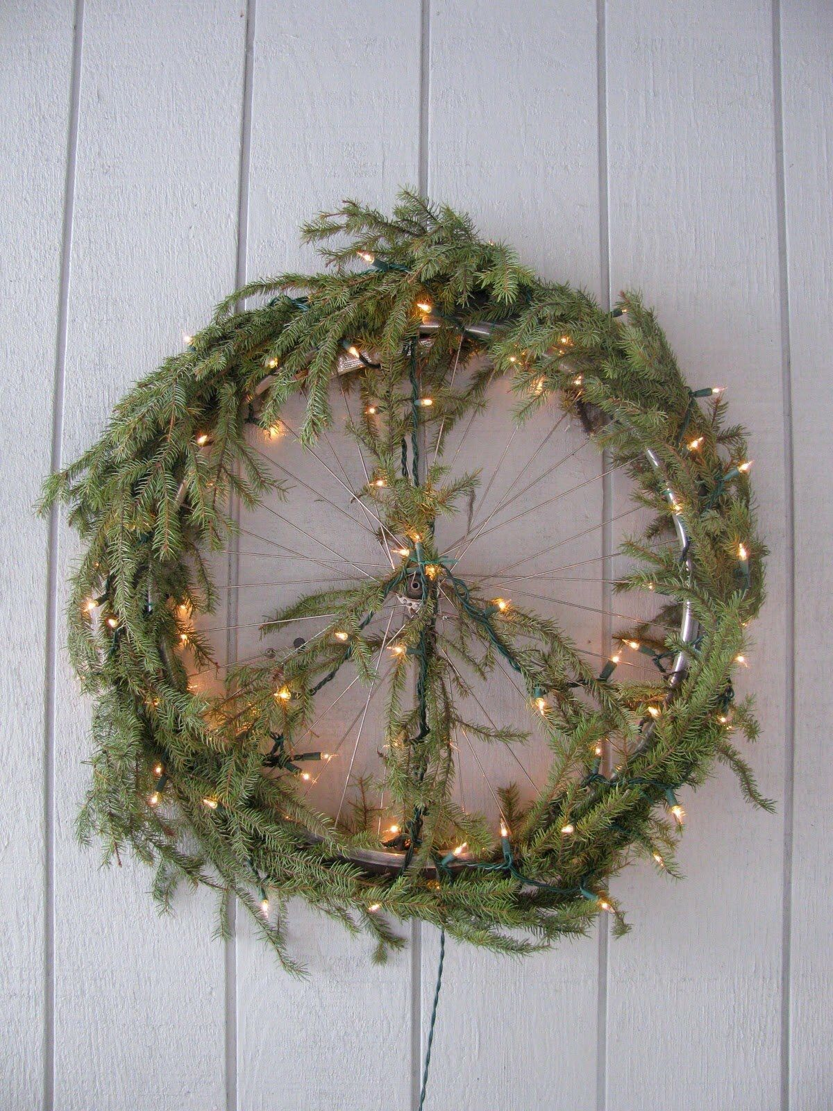 Peace sign made from tree branches & lights