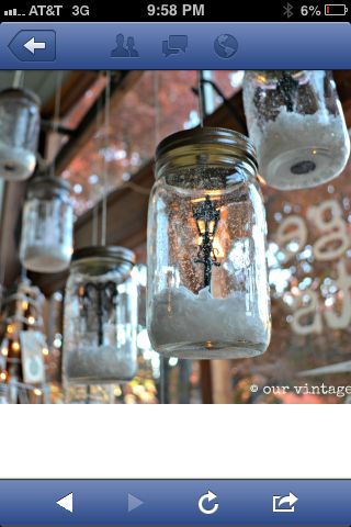 "Mason jar lightly sprayed with can snow. Small tree, animal figurine hot glued to the bottom of the jar. Fill bottom of jar with loose fake snow. Spraypaint lid antique brass or glitter of choice. Cute snow globe! From ""Our Vintage Home Love"""