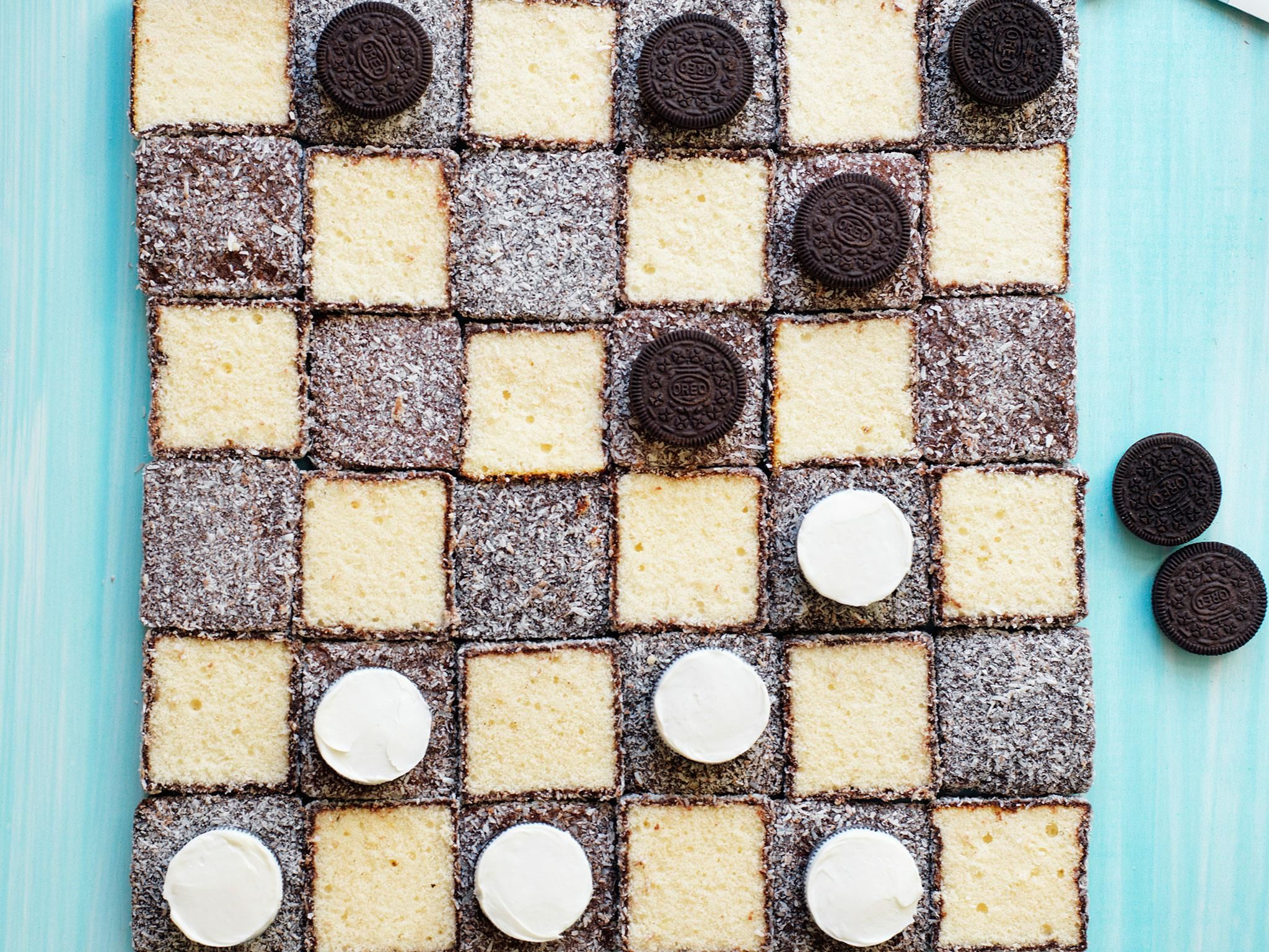Play edible checkers with this game cake! Use pink lamingtons for a pink themed checkerboard cake, if you prefer.