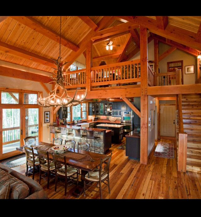 Open floor plan with loft wooden walls rustic abode for Small a frame cabin plans with loft